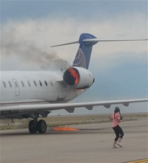 BREAKING United plane's engine catches fire during landing